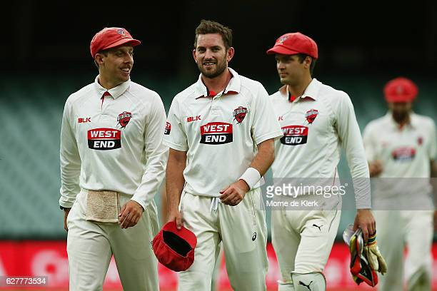 Jake Lehmann Chadd Sayers and Alex Carey of the Redbacks come from the field at the dinner break during day one of the Sheffield Shield match between...