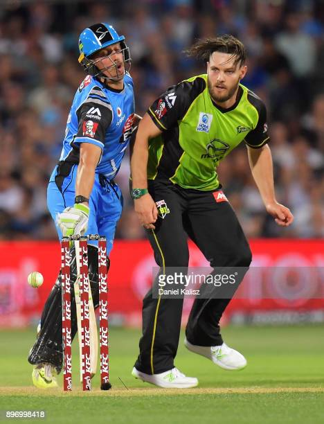 Jake Lehmann of the Adelaide Strikers and Mitchell McClenaghan of the Sydney Thunder collide during the Big Bash League match between the Adelaide...