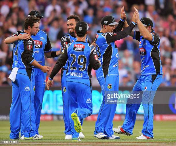 Jake Lehmann of the Adelaide Strikers celebrates with his team mates after taking a catch during the Big Bash League match between the Adelaide...