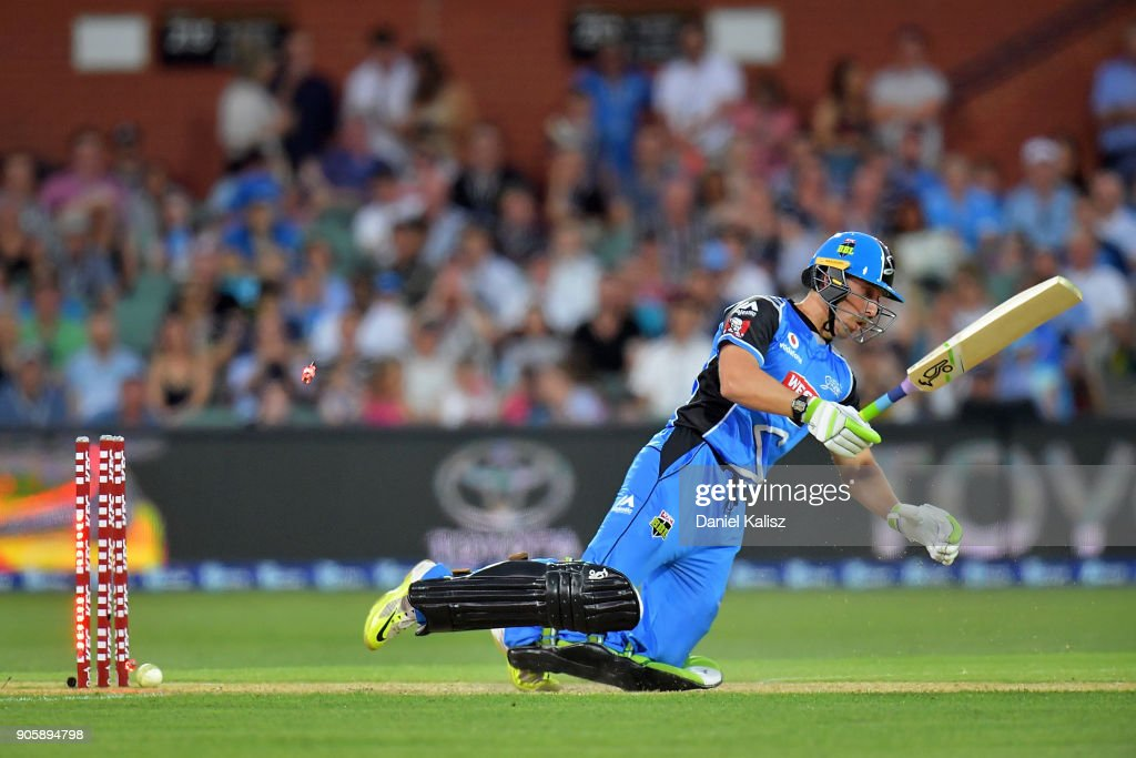 Jake Lehmann of the Adelaide Strikers falls after being bowled out by Jofra Archer of the Hobart Hurricanes during the Big Bash League match between the Adelaide Strikers and the Hobart Hurricanes at Adelaide Oval on January 17, 2018 in Adelaide, Australia.