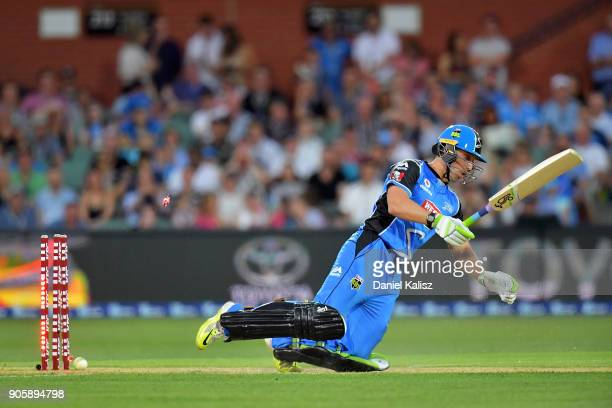 Jake Lehmann of the Adelaide Strikers falls after being bowled out by Jofra Archer of the Hobart Hurricanes during the Big Bash League match between...