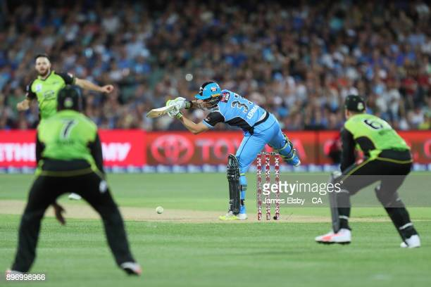 Jake Lehmann of the Adelaide Strikers swings at a wide ball during the Big Bash League match between the Adelaide Strikers and the Sydney Thunder at...