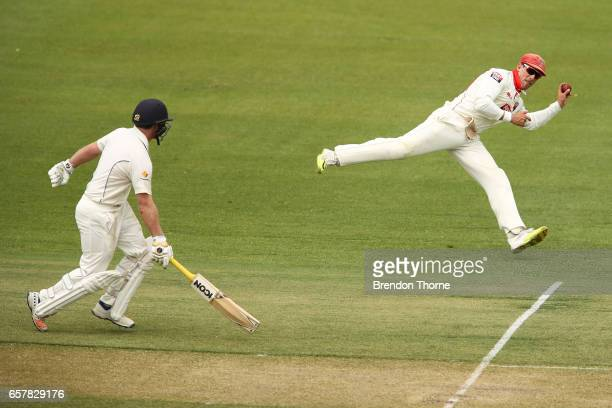 Jake Lehmann of the Redbacks attempts the run out of Marcus Harris of the Bushrangers during the Sheffield Shield final between Victoria and South...