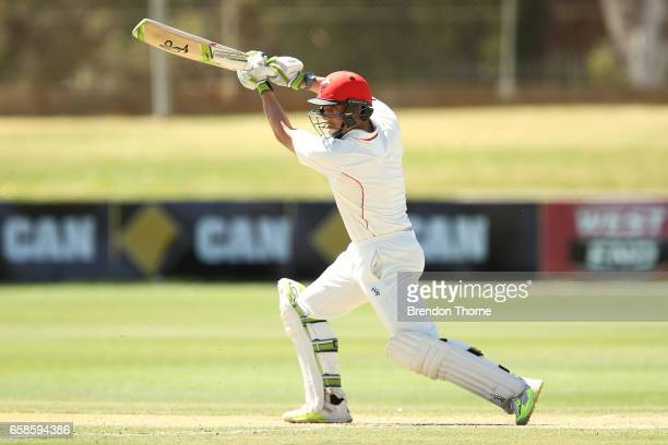 Jake Lehmann of the Redbacks plays a cover drive during the Sheffield Shield final between Victoria and South Australia on March 28 2017 in Alice...
