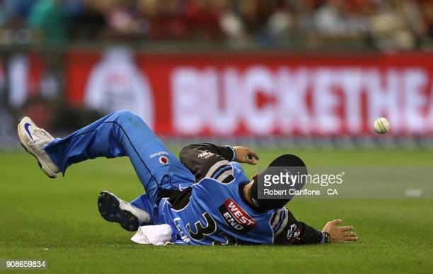 Jake Lehmann of the Strikers attempts to take a catch during the Big Bash League match between the Melbourne Renegades and the Adelaide Strikers at...