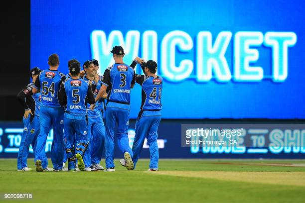 Jake Lehmann of the Strikers celebrates taking a catch with team mates to dismiss Shane Watson of the Thunder during the Big Bash League match...