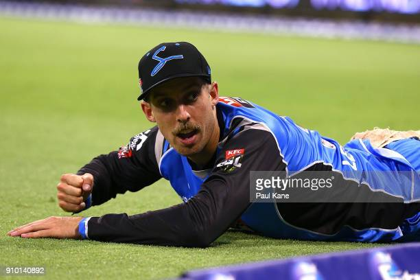 Jake Lehmann of the Strikers looks on after failing to save a boundary during the Big Bash League match between the Perth Scorchers and the Adelaide...
