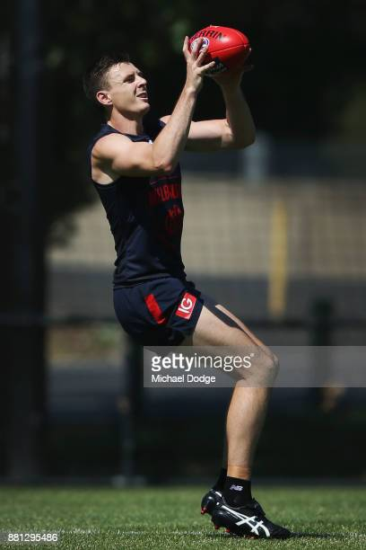 Jake Lever marks the ball during a Melbourne Demons AFL training session at Gosch's Paddock on November 29 2017 in Melbourne Australia