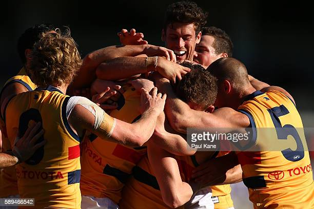 Jake Lever of the Crows is congratulated by team mates after kicking a goal during the round 21 AFL match between the Fremantle Dockers and the...