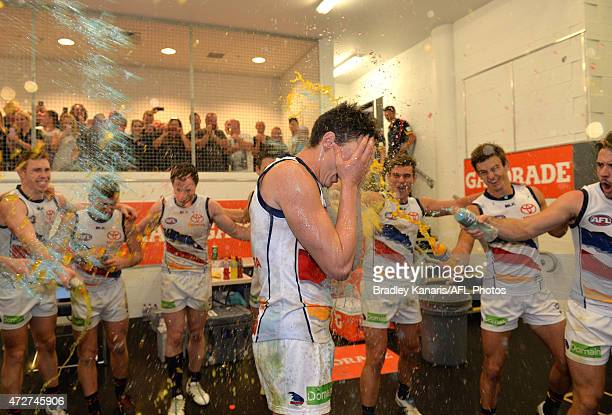 Jake Lever of the Crows is sprayed with Gatorade drink as he celebrates victory with his team mates after the round six AFL match between the Gold...