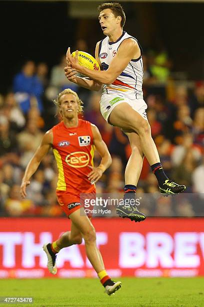 Jake Lever of the Crows takes a mark during the round six AFL match between the Gold Coast Suns and the Adelaide Crows at Metricon Stadium on May 9...
