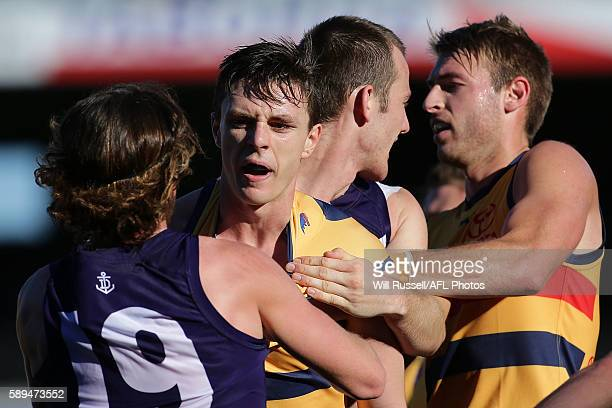 Jake Lever of the Crows wrestles with Connor Blakely of the Dockers during the round 21 AFL match between the Fremantle Dockers and the Adelaide...