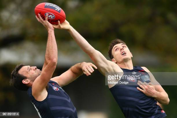 Jake Lever of the Demons and Cam Pedersen compete for the ball during a Melbourne Demons AFL training session at Gosch's Paddock on May 24 2018 in...