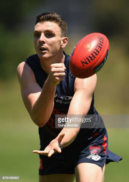 Jake Lever of the Demons handballs during a Melbourne Demons AFL preseason training session at Gosch's Paddock on November 20 2017 in Melbourne...