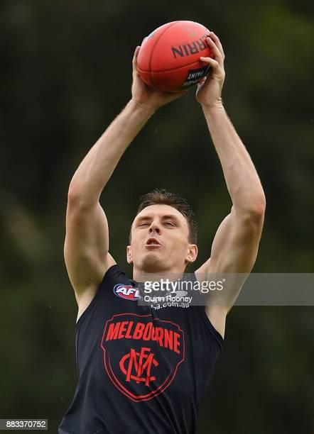 Jake Lever of the Demons marks during a Melbourne Demons AFL training session at Gosch's Paddock on December 1 2017 in Melbourne Australia