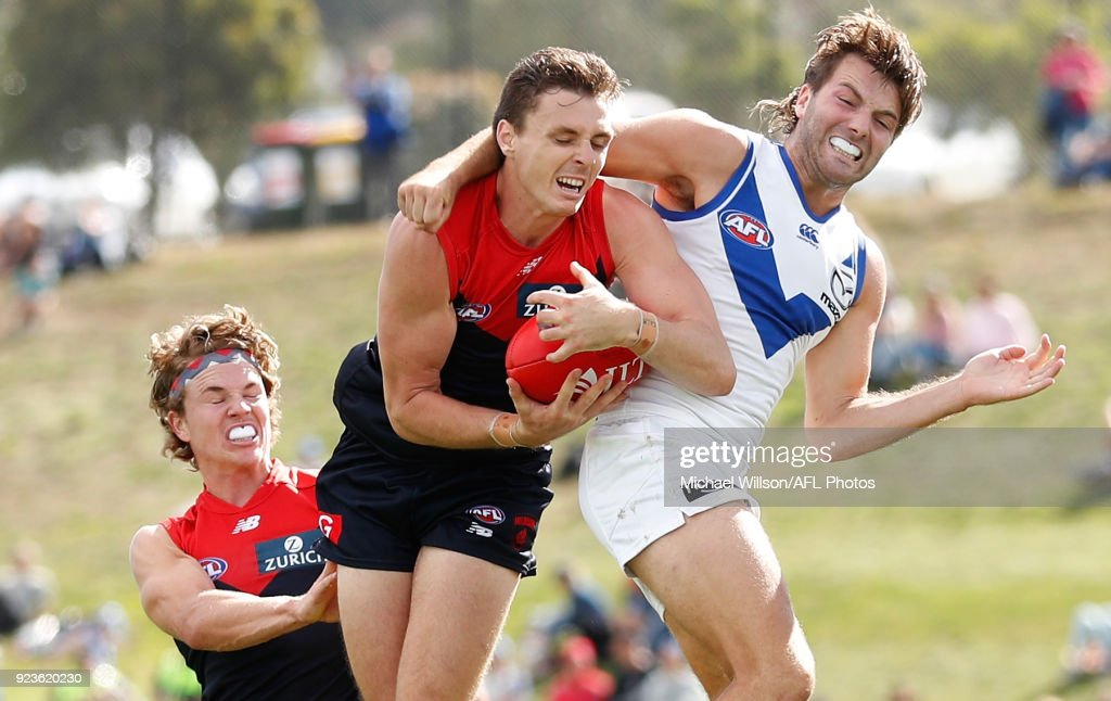 Jake Lever of the Demons marks the ball ahead of Luke McDonald of the Kangaroos during the AFL 2018 JLT Community Series match between the North Melbourne Kangaroos and the Melbourne Demons at Kingborough Oval on February 24, 2018 in Hobart, Australia.