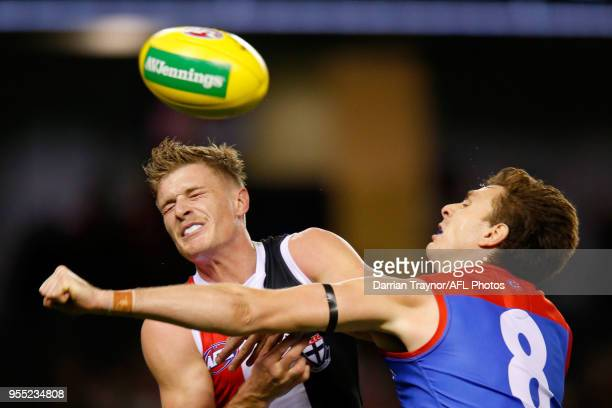 Jake Lever of the Demons spoils Jack Newnes of the Saints during the round seven AFL match between St Kilda Saints and the Melbourne Demons at Etihad...