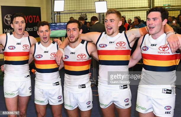 Jake Lever Rory Atkins Richard Douglas Hugh Greenwood and Mitchell McGovern of the Crows sing the song in the rooms after winning the round 21 AFL...