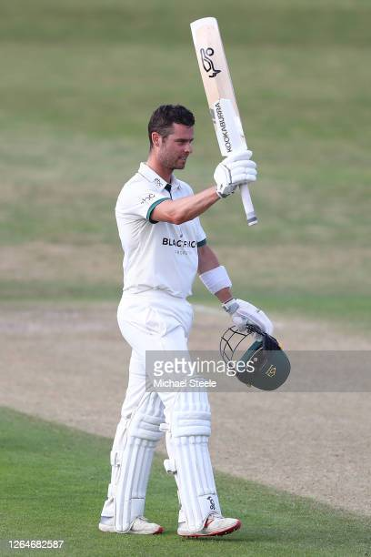 Jake Libby of Worcestershire raises his bat after reaching his century during day one of the Bob Willis Trophy Central Group match between...