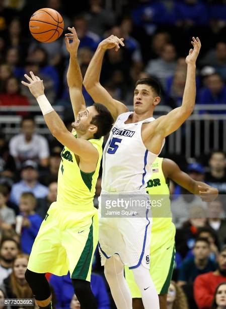 Jake Lindsey of the Baylor Bears battles Martin Krampelj of the Creighton Bluejays for a rebound during the National Collegiate Basketball Hall Of...