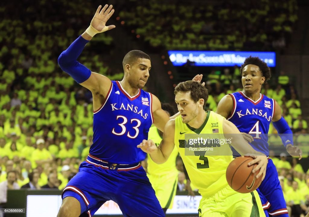 Jake Lindsey #3 of the Baylor Bears drives toward the basket as Landen Lucas #33 of the Kansas Jayhawks and Devonte' Graham #4 of the Kansas Jayhawks defend in the first half at the Ferrell Center on February 18, 2017 in Waco, Texas.