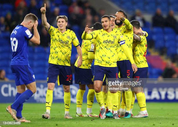 Jake Livermore and Adam Reach of West Bromwich Albion celebrate their sides second goal scored by Curtis Nelson of Cardiff City during the Sky Bet...