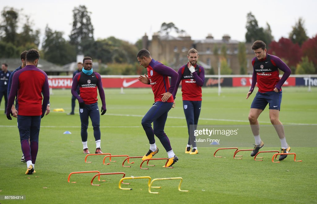 Jake Livermore and Harry Maguire of England warm up during an England training session at Hotspur Way on October 4, 2017 in Enfield, England.
