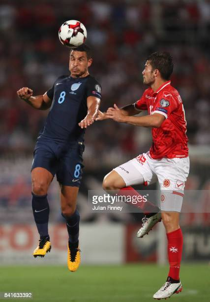 Jake Livermore of England jumps with Bjorn Kristensen of Malta during the FIFA 2018 World Cup Qualifier between Malta and England at Ta'Qali National...