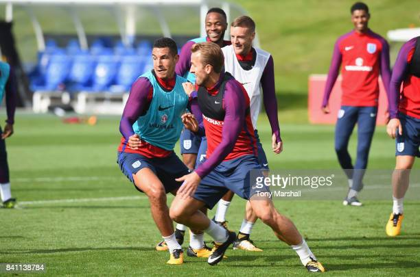 Jake Livermore of England tackles Harry Kane of England during an England training session at St Georges Park on August 31 2017 in BurtonuponTrent...