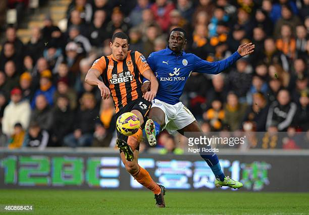 Jake Livermore of Hull City and Jeffrey Schlupp of Leicester City battle for the ball during the Barclays Premier League match between Hull City and...