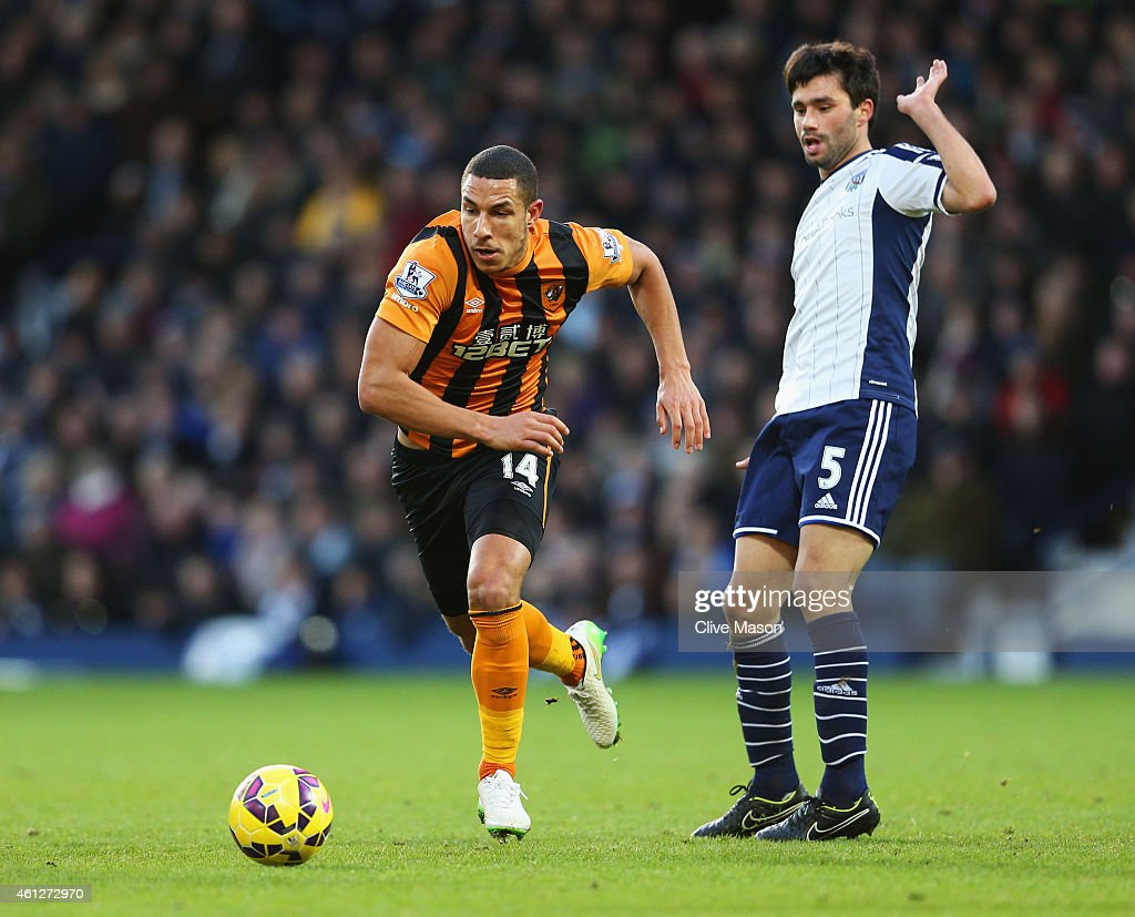 Jake Livermore of Hull City evades Claudio Yacob of West Bromwich Albion during the Barclays Premier League match between West Bromwich Albion and Hull City at The Hawthorns on January 10, 2015 in West Bromwich, England.