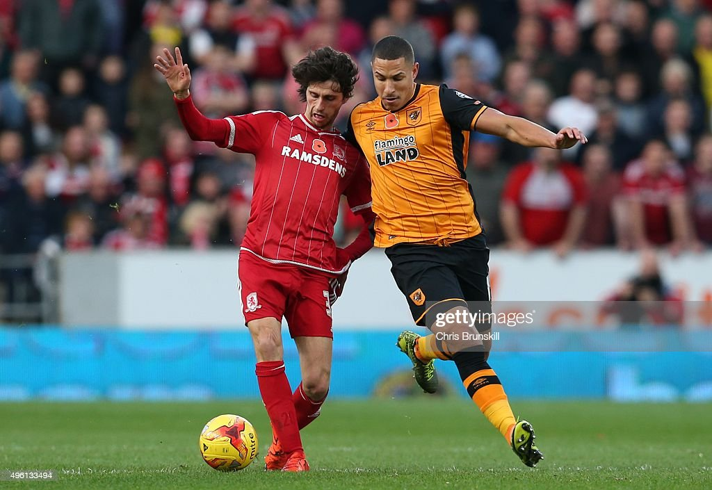 Jake Livermore of Hull City in action with Diego Fabbrini of Middlesbrough during the Sky Bet Championship match between Hull City and Middlesbrough at the KC Stadium on November 7, 2015 in Hull, England.
