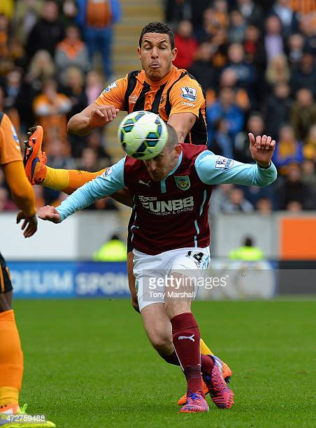 Jake Livermore of Hull City tackles David Jones of Burnley during the Barclays Premier League match between Hull City and Burnley at KC Stadium on...