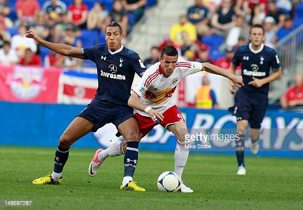 Jake Livermore of Tottenham Hotspur plays the ball against Sebastien Le Toux of the New York Red Bulls during the game at Red Bull Arena on July 31...