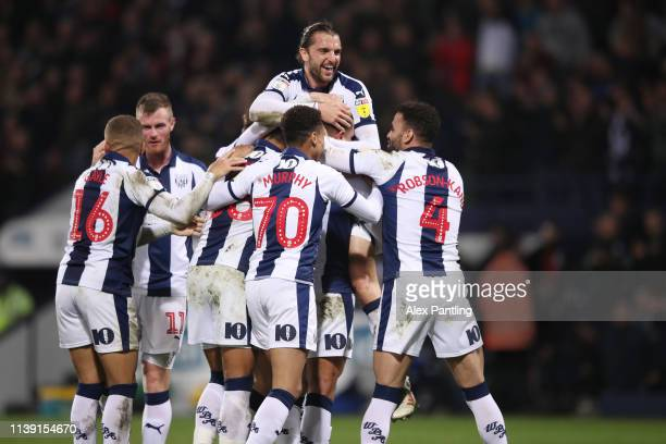 Jake Livermore of West Brom is mobbed by team mates after scoring to make it 32 during the Sky Bet Championship match between West Bromwich Albion...