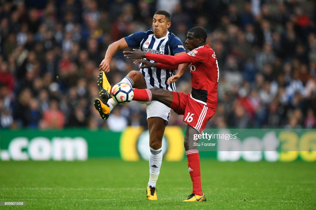 Jake Livermore of West Bromwich Albion and Abdoulaye Doucoure of Watford compete for the ball during the Premier League match between West Bromwich Albion and Watford at The Hawthorns on September 30, 2017 in West Bromwich, England.