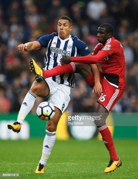 Jake Livermore of West Bromwich Albion and Abdoulaye Doucoure of Watford compete for the ball during the Premier League match between West Bromwich...