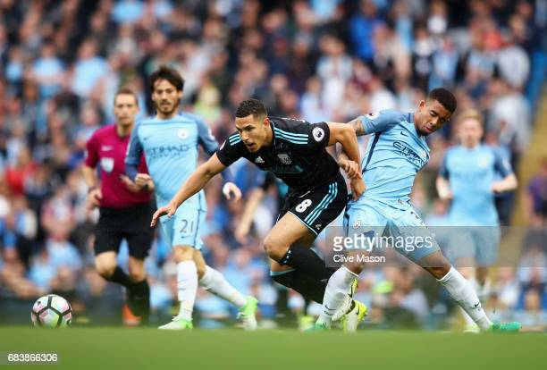 Jake Livermore of West Bromwich Albion and Gabriel Jesus of Manchester City battle for possession during the Premier League match between Manchester...
