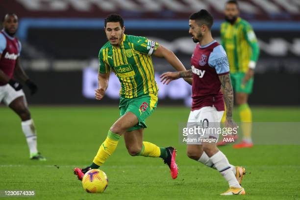 Jake Livermore of West Bromwich Albion and Manuel Lanzini of West Ham United during the Premier League match between West Ham United and West...