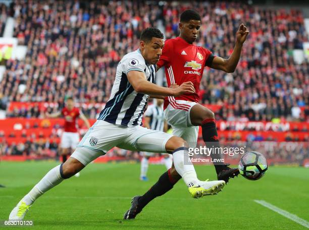 Jake Livermore of West Bromwich Albion and Marcus Rashford of Manchester United battle for possession during the Premier League match between...