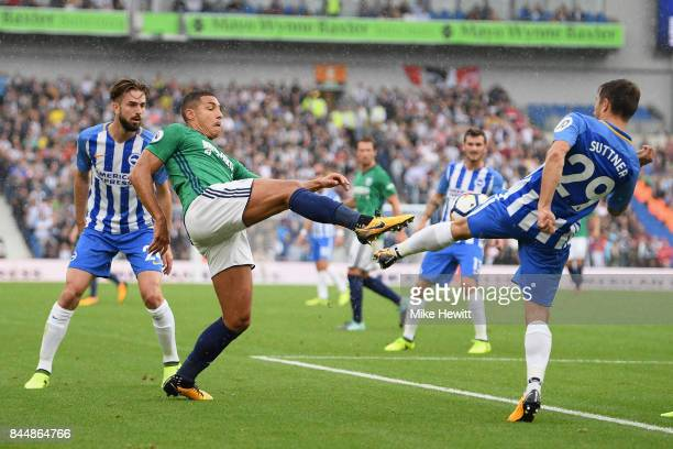 Jake Livermore of West Bromwich Albion and Markus Suttner of Brighton and Hove Albion battle for possession during the Premier League match between...