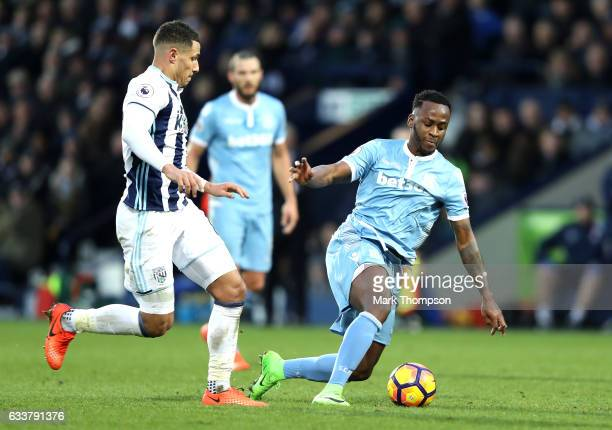 Jake Livermore of West Bromwich Albion attempts to get past Saido Berahino of Stoke City during the Premier League match between West Bromwich Albion...