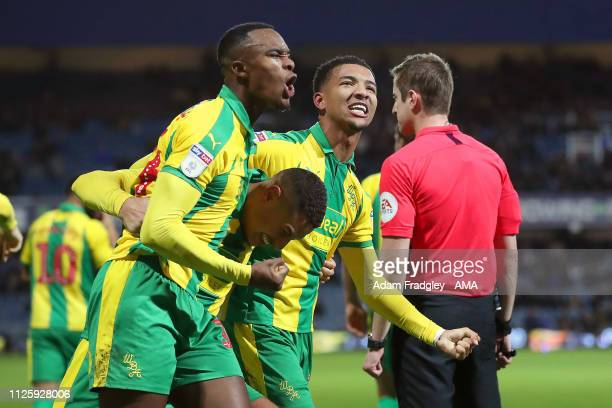 Jake Livermore of West Bromwich Albion celebrates after scoring a goal to make it 23 with Rekeem Harper of West Bromwich Albion and Mason Holgate of...