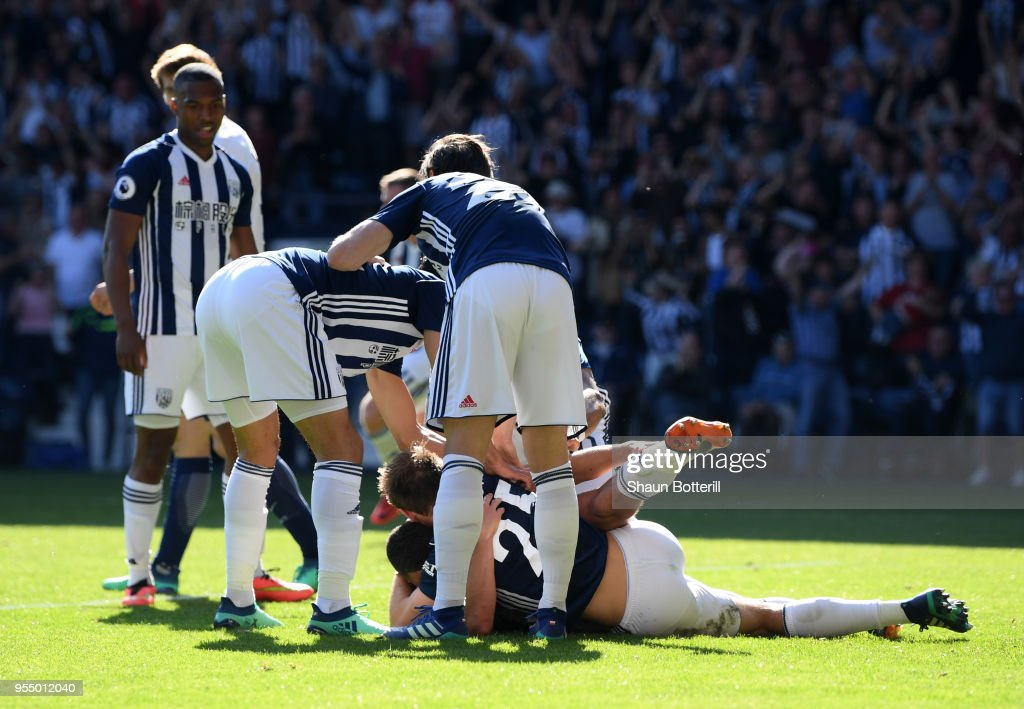 Jake Livermore of West Bromwich Albion (obscured) celebrates with teammates after scoring his sides first goal during the Premier League match between West Bromwich Albion and Tottenham Hotspur at The Hawthorns on May 5, 2018 in West Bromwich, England.
