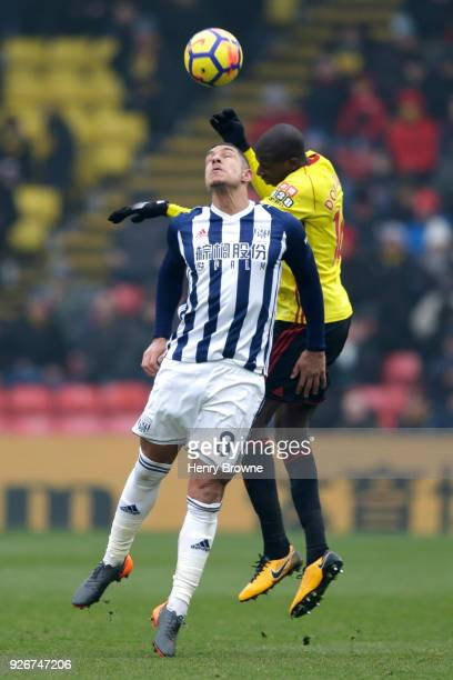 Jake Livermore of West Bromwich Albion competes for a header with Abdoulaye Doucoure of Watford during the Premier League match between Watford and...