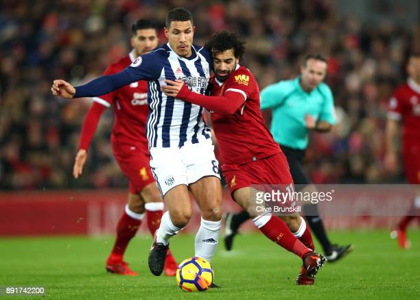 Jake Livermore of West Bromwich Albion is challenged by Mohamed Salah of Liverpool during the Premier League match between Liverpool and West...