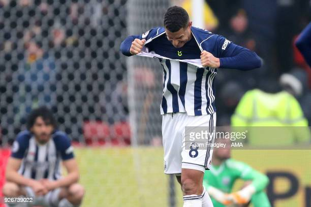Jake Livermore of West Bromwich Albion reacts as he rips his shirt in frustration after West Bromwich Albion concede a goal to make it 10 during the...