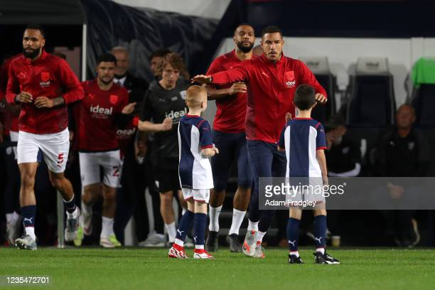 Jake Livermore of West Bromwich Albion ruffles the hair of the mascots as the players run out for the warm up ahead of the Sky Bet Championship match...