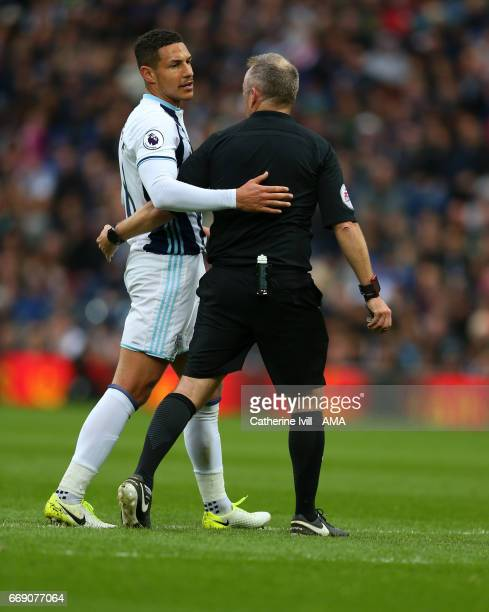 Jake Livermore of West Bromwich Albion talks to referee Jon Moss during the Premier League match between West Bromwich Albion and Liverpool at The...