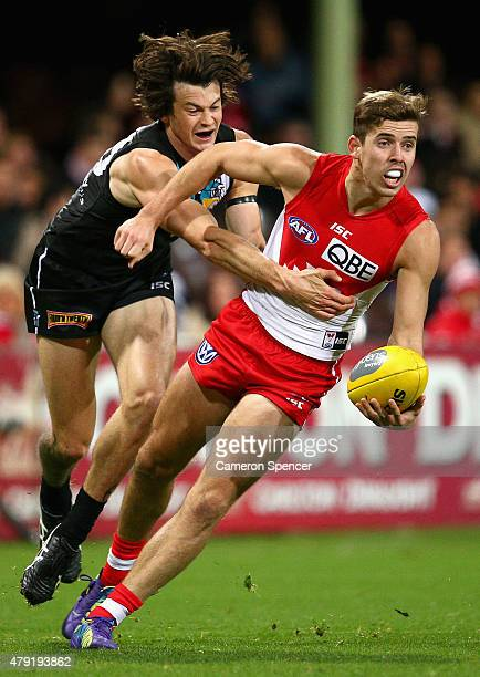 Jake Lloyd of the Swans is tackled during the round 14 AFL match between the Sydney Swans and the Port Adelaide Power at SCG on July 2 2015 in Sydney...